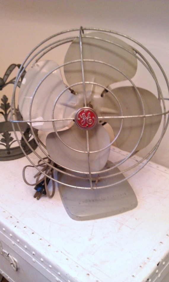 Vintage ge metal oscillating fan and it