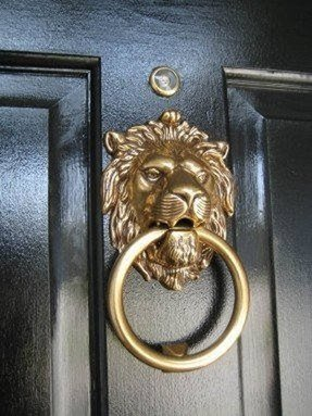 Brass lion head door knocker