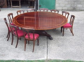 https://foter.com/photos/272/round-dining-room-table-seats-12.jpg?s=pi