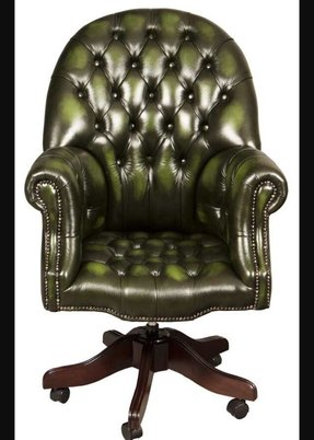 With buttoned green leather from top to seat the directors