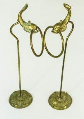 A pair of vintage brass hand towel