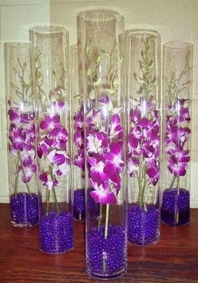 Tall orchids centerpiece can these go in water with floating