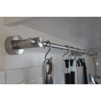 Wall mounted kitchen utensil holder