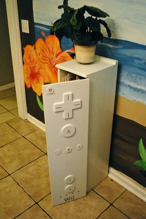 A childrens bookcase cabinet with a wii 1