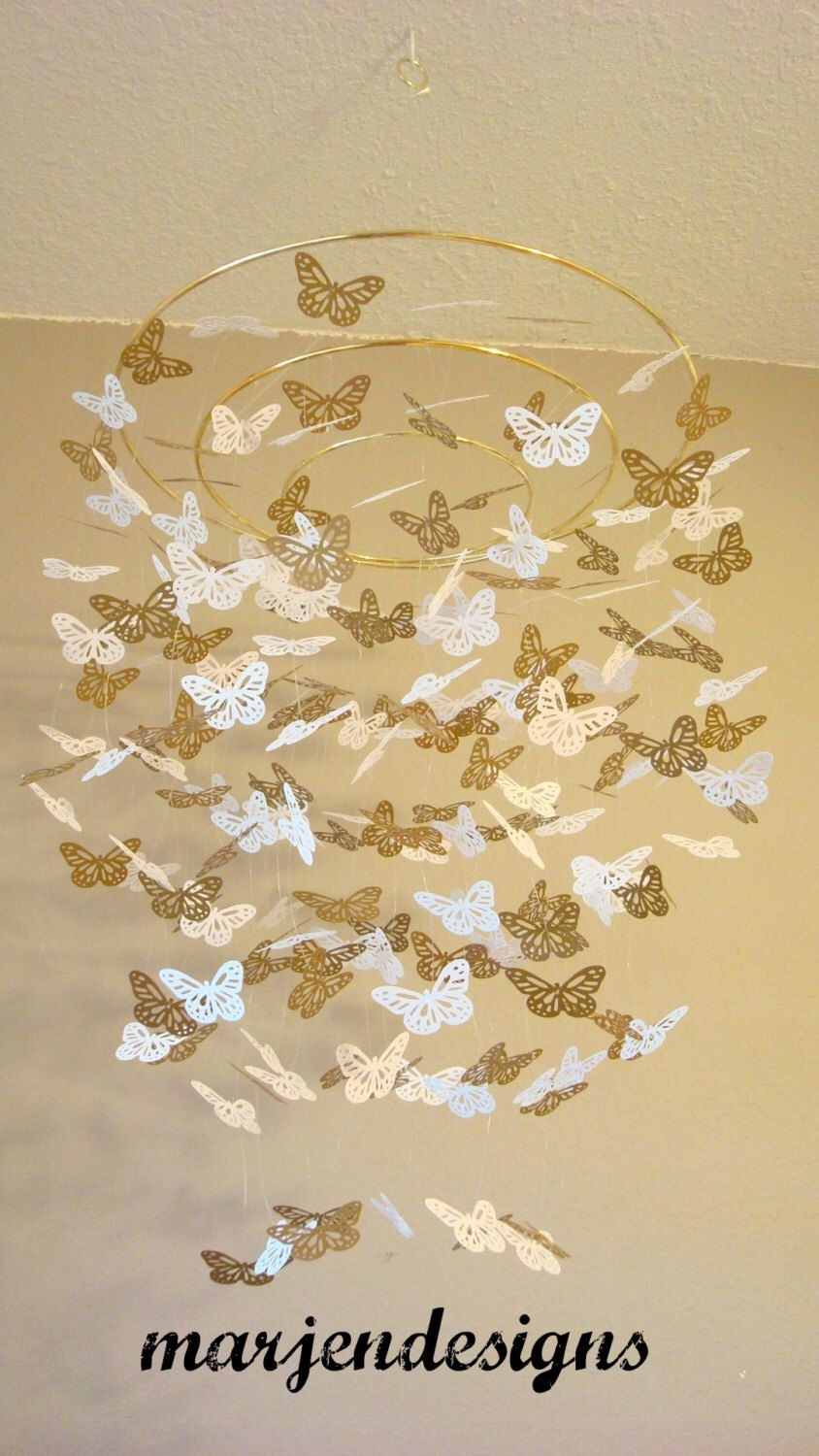 Gold and white butterfly mobile crib