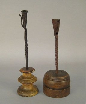 Two wrought iron candlesticks 18th c with turned wood bases