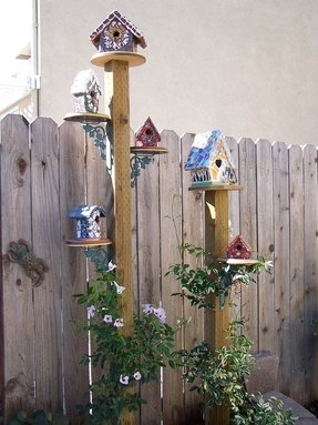 Wooden bird feeder stands