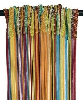 Take a look at this rainbow fringe curtain panel by