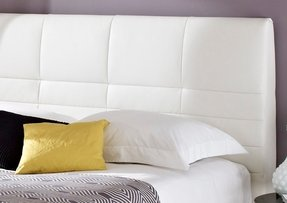 White leather bed with crystals