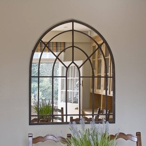 Aged metal arched wall mirror