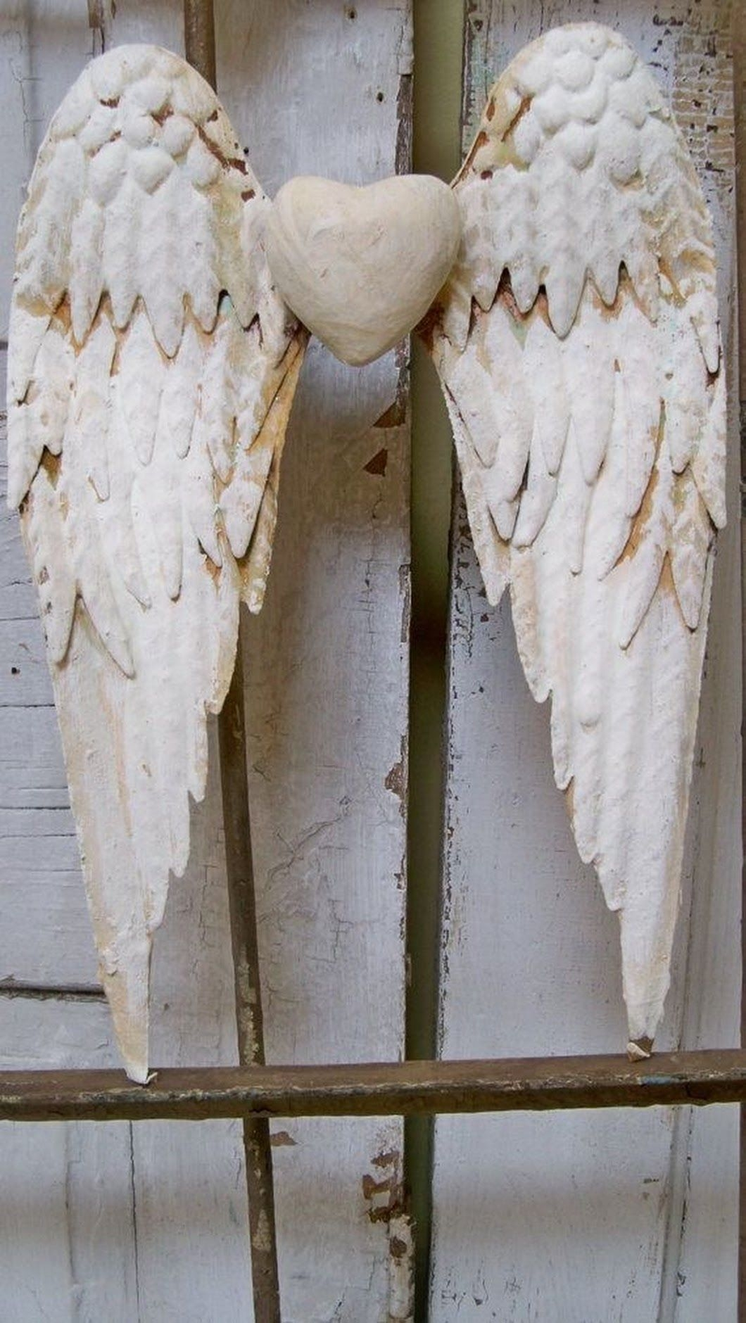 White wings rusty metal with heart