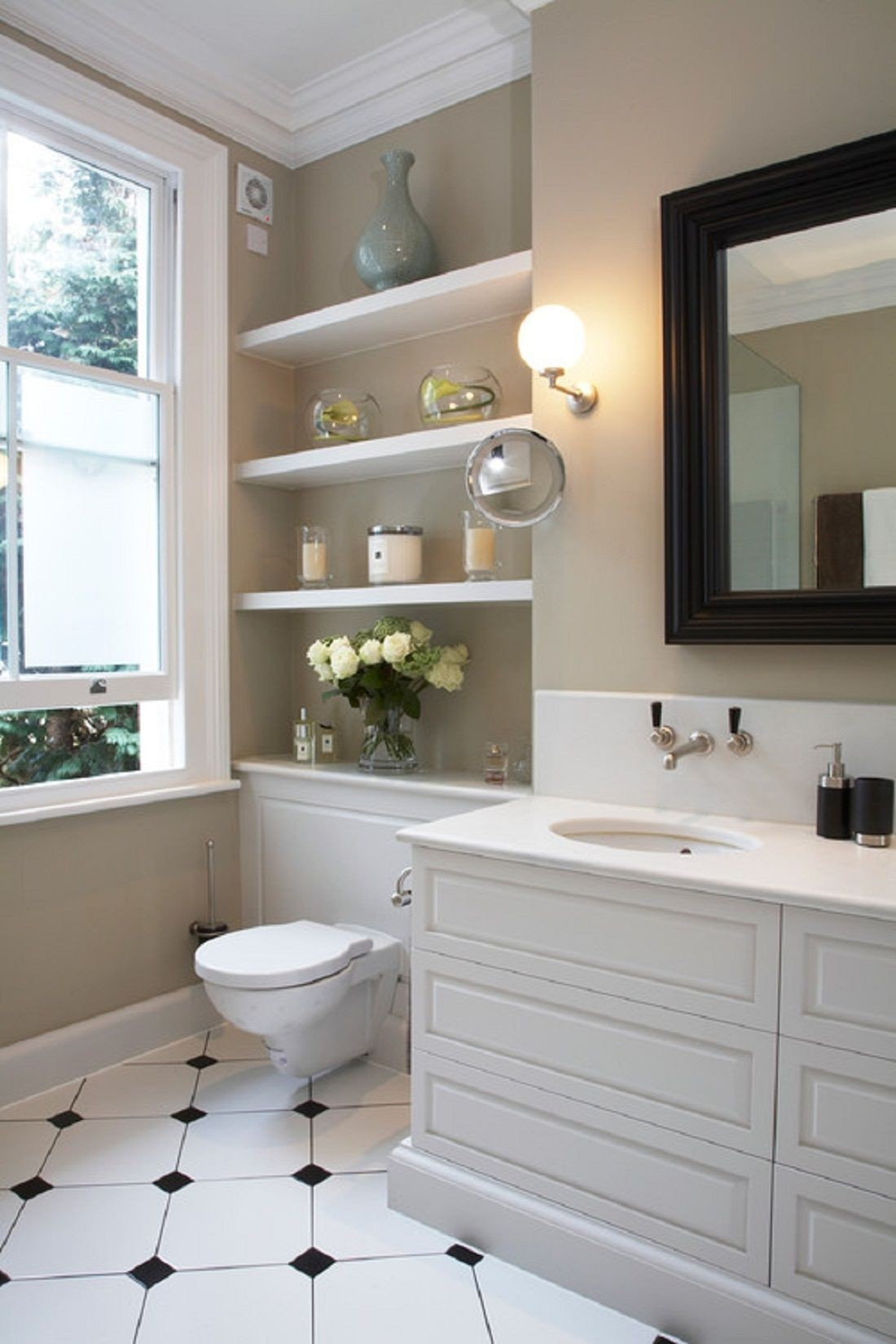 Charmant Shelves Over The Toilet In A Modern Bathroom. Behind Toilet Shelves Might  Be Built Into A Wall Or Delivered With A Separate Wall Mounted Cabinet    Here The ...