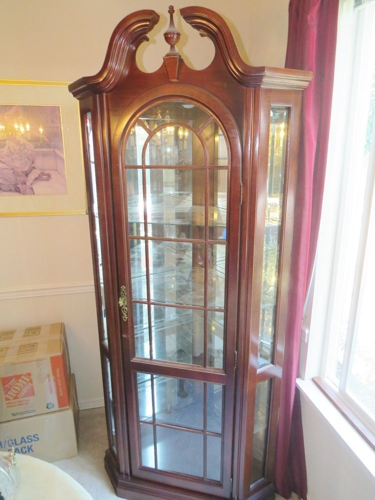 Pulaski furniture lighted corner cherry pediment top curio cabinet
