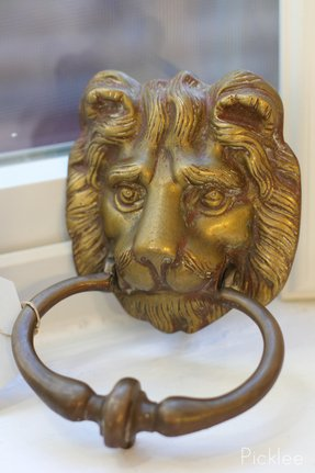 Brass lion head door knocker 42