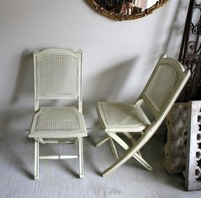 Vintage shabby chic white folding chairs