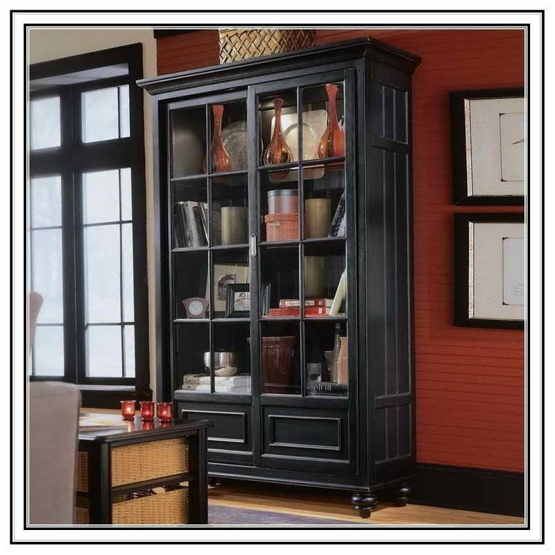 Library bookcase with glass doors with furniture and library bookcase