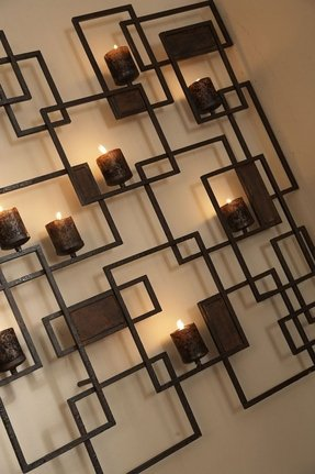 Metal wall art with candles