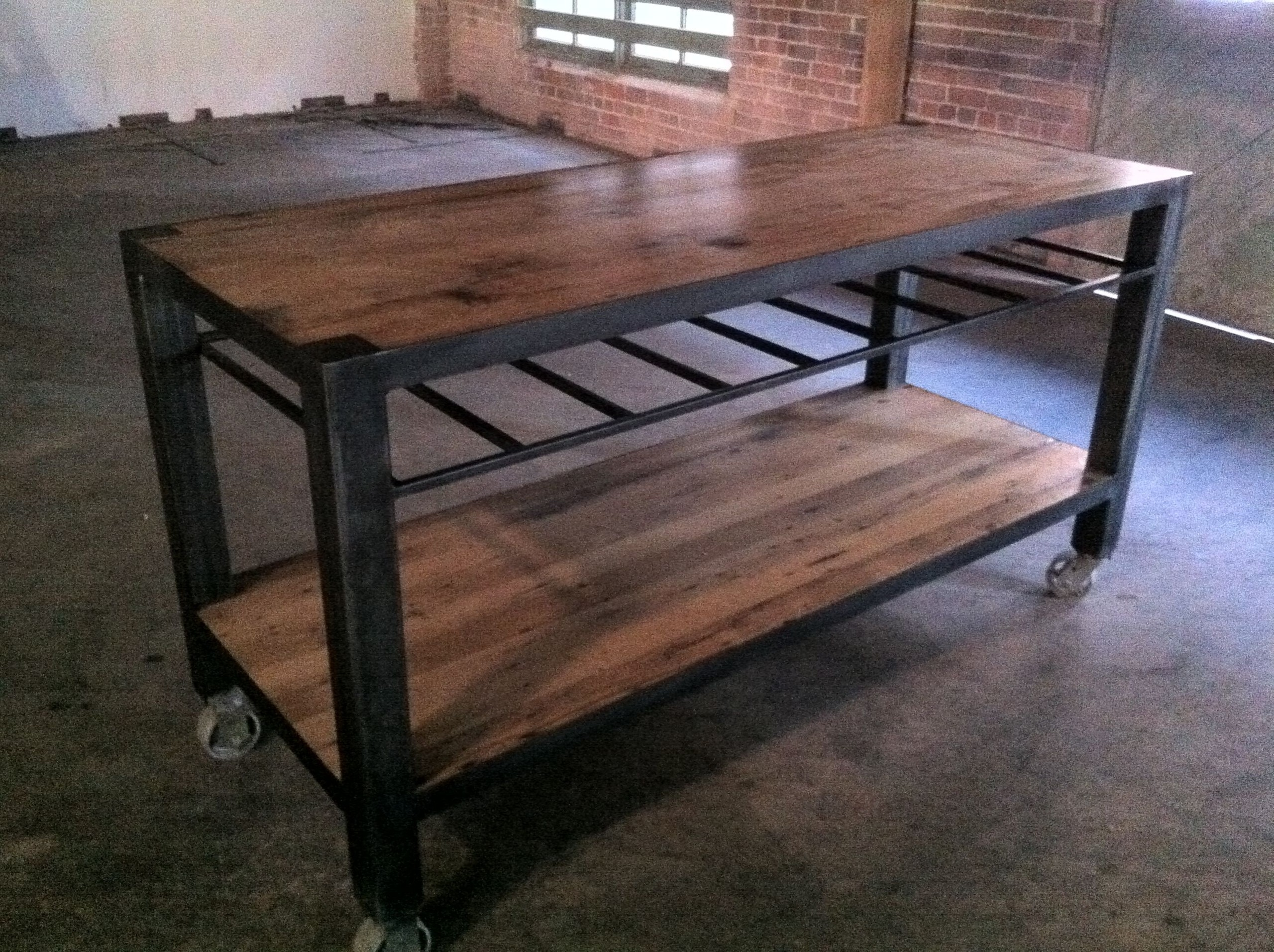 Kitchen Island Made Of Reclaimed Oak With Steel Base And