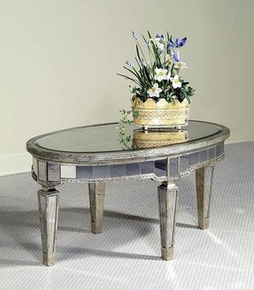Oval antique mirrored coffee table