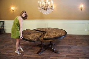 https://foter.com/photos/290/jupe-table-large-round-walnut-dining-room-table-seats-6-10-people-6.jpg?s=pi