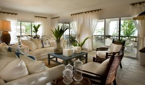 Living room white sofa sest and wicker chairs for tropical