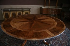 Large round mahogany dining table w leaves perimeter 1