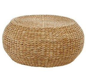 Handwoven of natural seagrass this round woven coffee table reveals