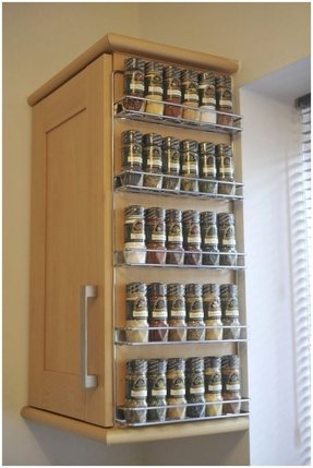 Spice rack from brushed nickel on corner wall mount cabinet