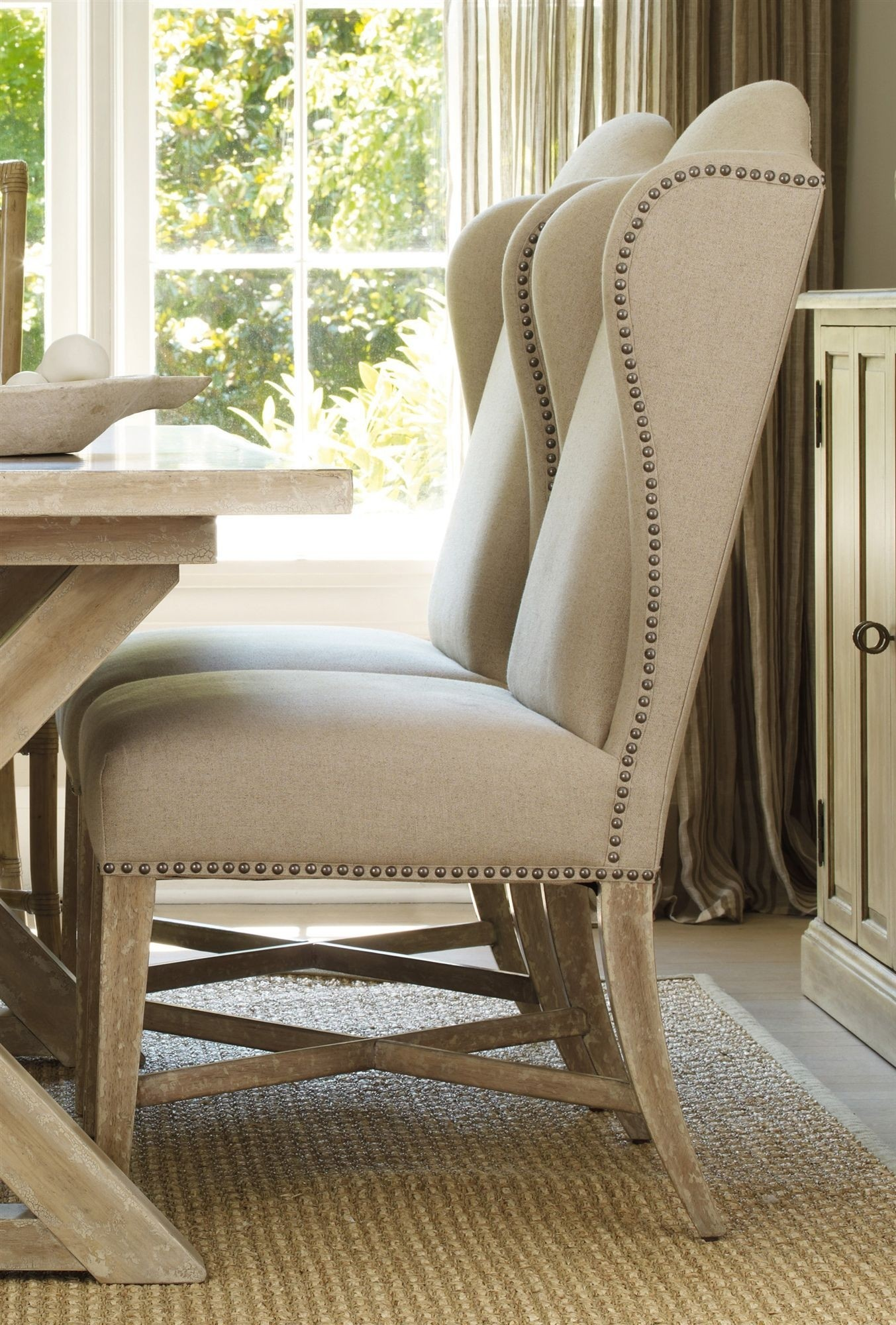 Wing Back Dining Chairs And Wooden Sideboard Plus Brown Pottery