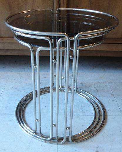 Of 3 chrome and glass nesting tables with a hint