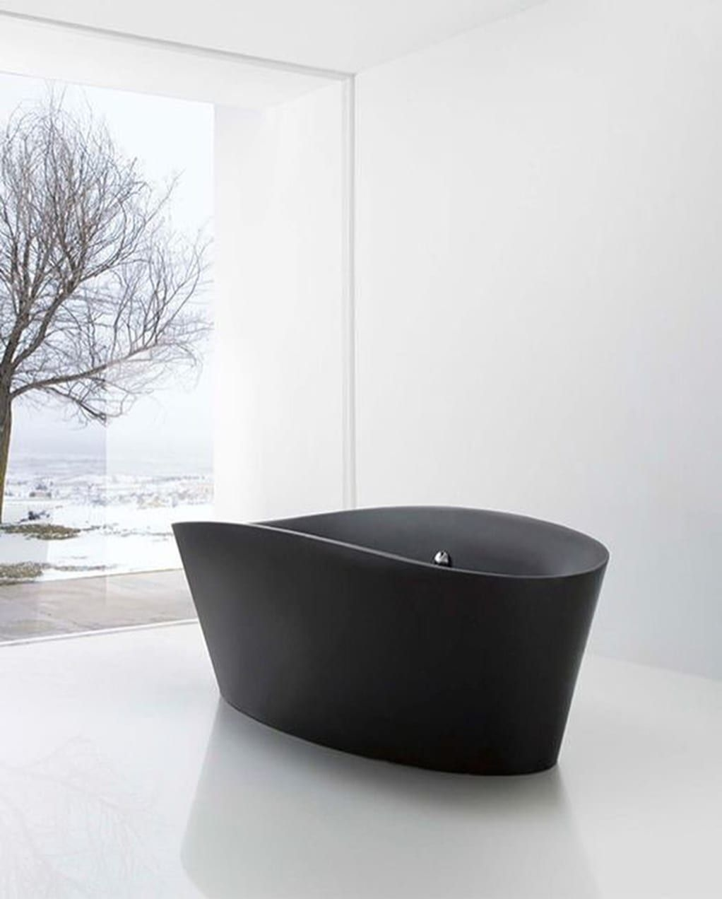 Attirant An Interesting A Bit Futuristic Bathtub Crafted Of Matte Black Acrylic. It  Has An Elongated Ovalish Tapered Downwards Body And Elevated Edges On  Longer ...