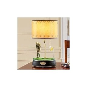 Golfer lamp foter a fancy table lamp that all the fans of golf will just love it consists of a lamp shade in a traditional design in a warm yellow color aloadofball Gallery