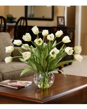 Large artificial flowers in vase