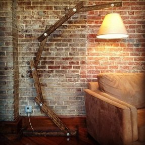 Rustic wooden floor lamp by a walk through the woods