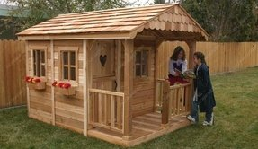 Wooden backyard playhouse