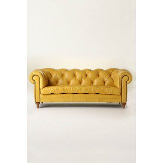 Pale yellow leather sofa