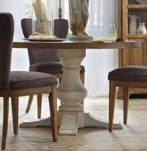 Whitewashed round dining table