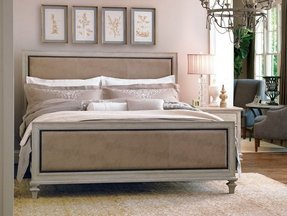 Upholstered bed with wood trim