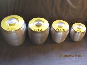 Vintage kromex 8 piece canister set with yellow plastic lids