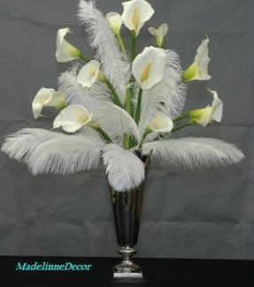 Artificial lilies in vase