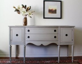 A Phenomenal Sideboard In Vintage Style It S Wooden Piece But Painted Cly Grey Color With Slightly Distressed Finish