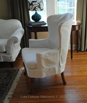 Slipcovered wingback chair 24