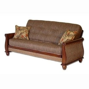Futon Having A Sy Wooden Frame In Mid Brown It Has Low Turned Bun Feet Sleigh Inspired Arms With Rosette Motifs On Front Panels Of Woven Rattan
