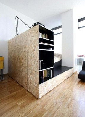 Bed with shelves around it