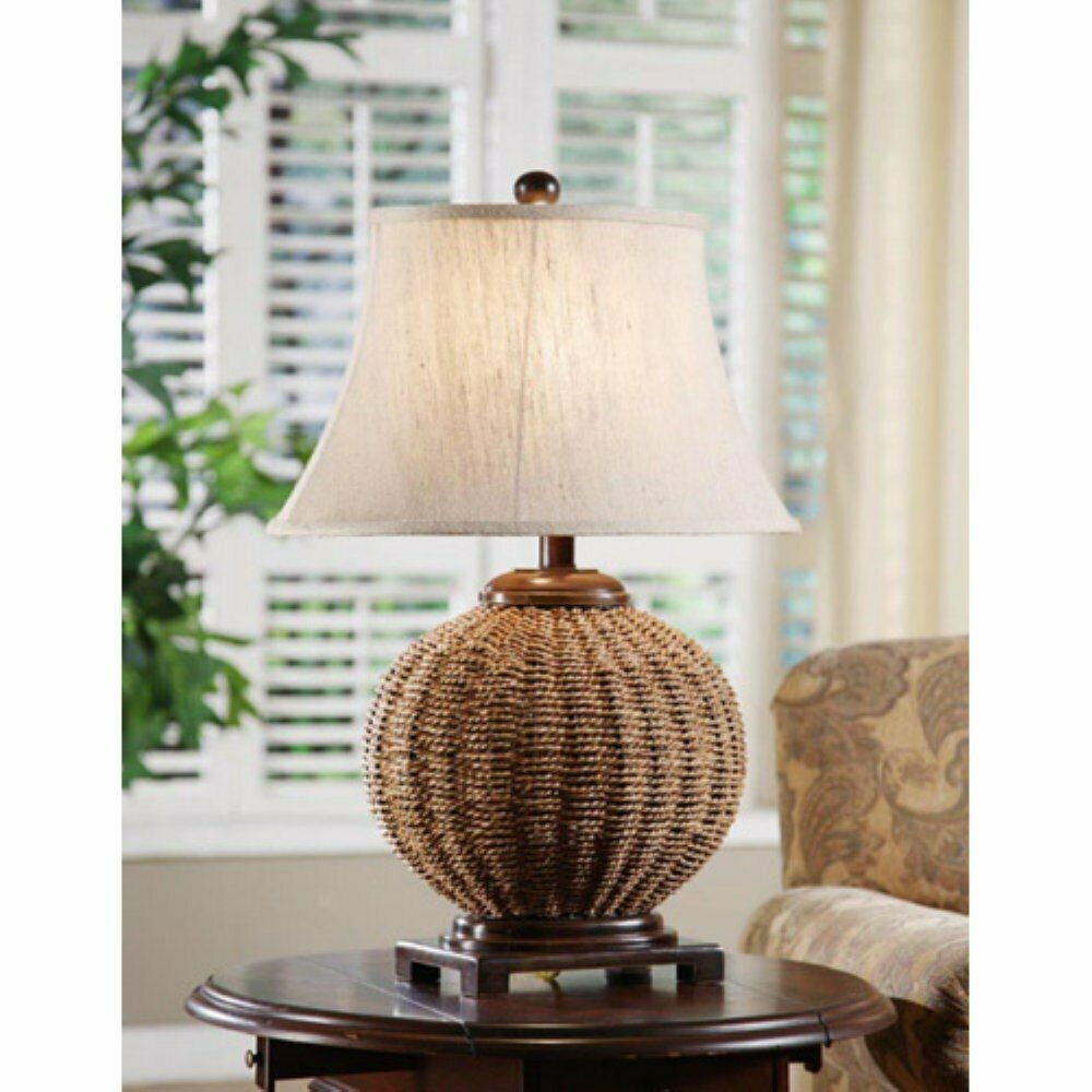Small Table Lamp With A Durable Woven Wicker Frame. This Natural Looking  Element Not Only Decorates Indoors, But It Also Provides Good Illumination.