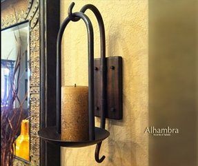 Wrought iron compliments plaster walls and warm tuscan wall colors