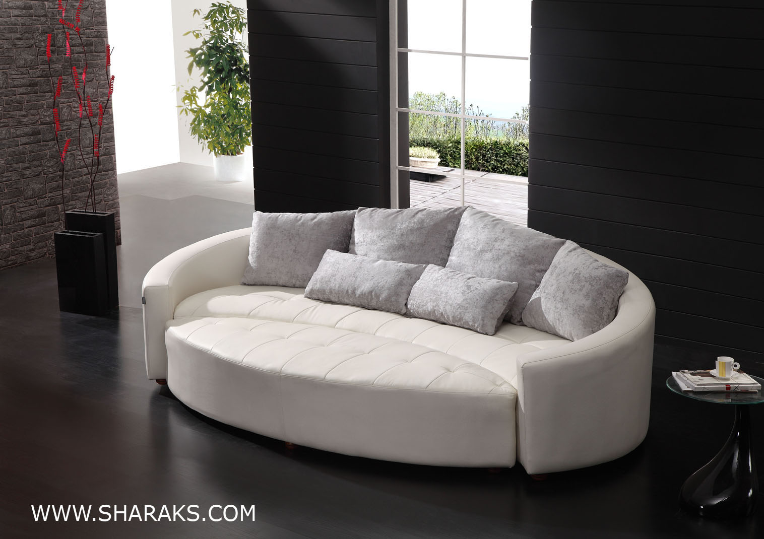 Curved sofas and loveseats cornering the curved leather sofas market