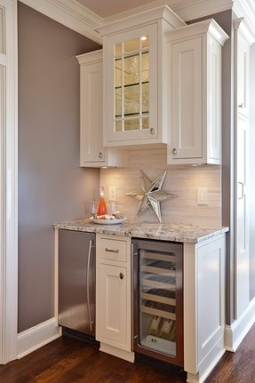 White Cabinet Wetbar With A Mini Fridge And Wine Cooler
